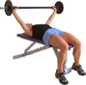 can be performed with either flat or inclined bench