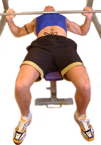 lower the bar smoothly towards your chest